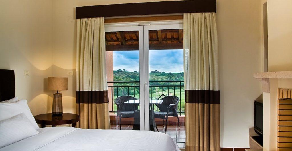 https://golftravelpeople.com/wp-content/uploads/2019/04/Dolce-Campo-Real-Resort-residences-3-bedroom-townhouses-bedroom-1024x529.jpg