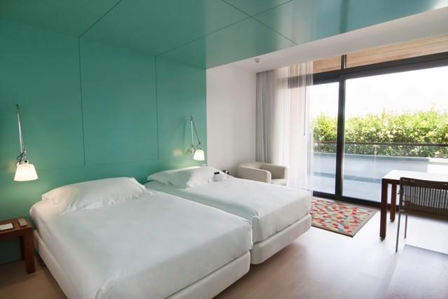 https://golftravelpeople.com/wp-content/uploads/2019/04/Emporda-Golf-and-Spa-Resort-Bedrooms-2.jpg