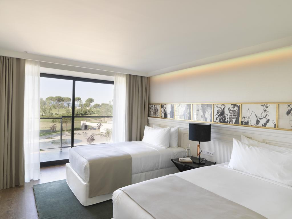 https://golftravelpeople.com/wp-content/uploads/2019/04/Hotel-Camiral-at-PGA-Catalunya-Resort-Bedrooms-1.jpg
