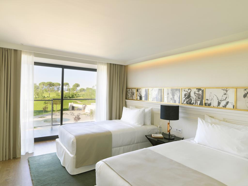 https://golftravelpeople.com/wp-content/uploads/2019/04/Hotel-Camiral-at-PGA-Catalunya-Resort-Bedrooms-6.jpg