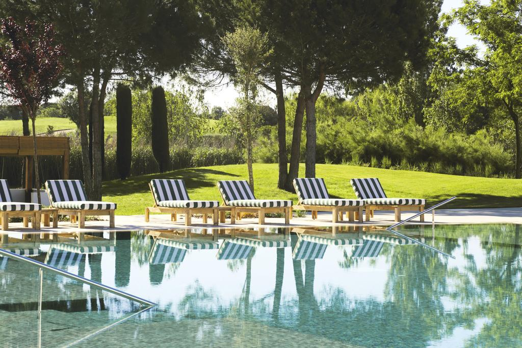https://golftravelpeople.com/wp-content/uploads/2019/04/Hotel-Camiral-at-PGA-Catalunya-Resort-Swimming-Pools-5.jpg