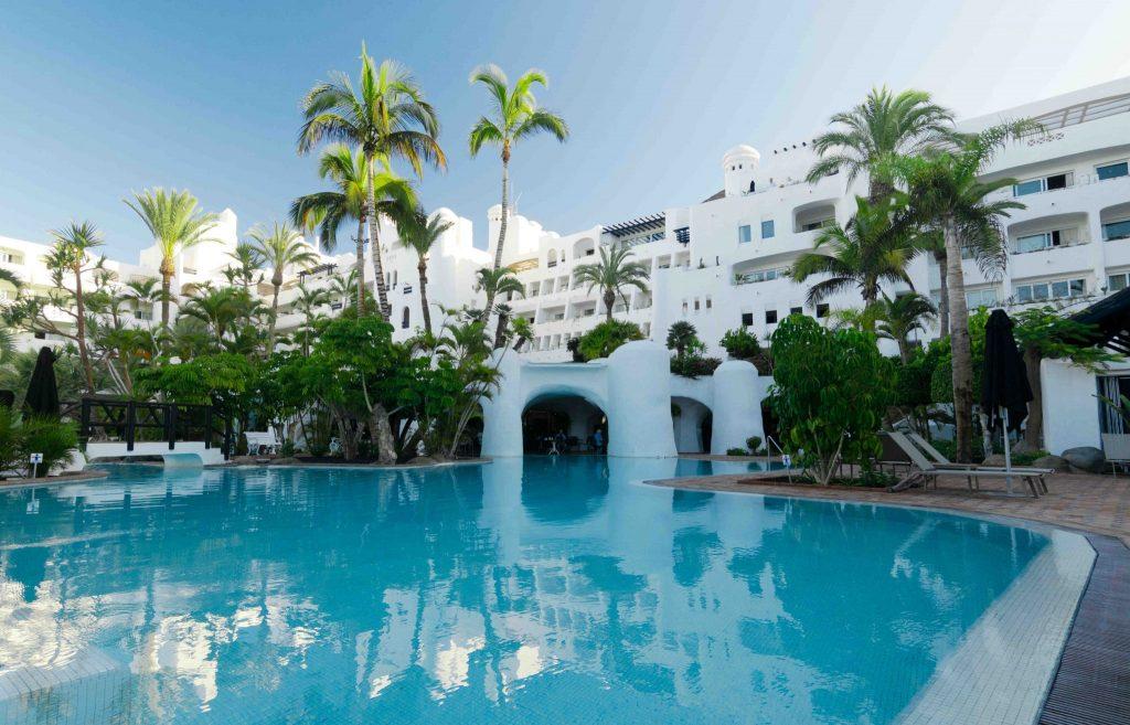 https://golftravelpeople.com/wp-content/uploads/2019/04/Hotel-Jardin-Tropical-Swimming-Pools-Gym-comp-3-1024x657.jpg