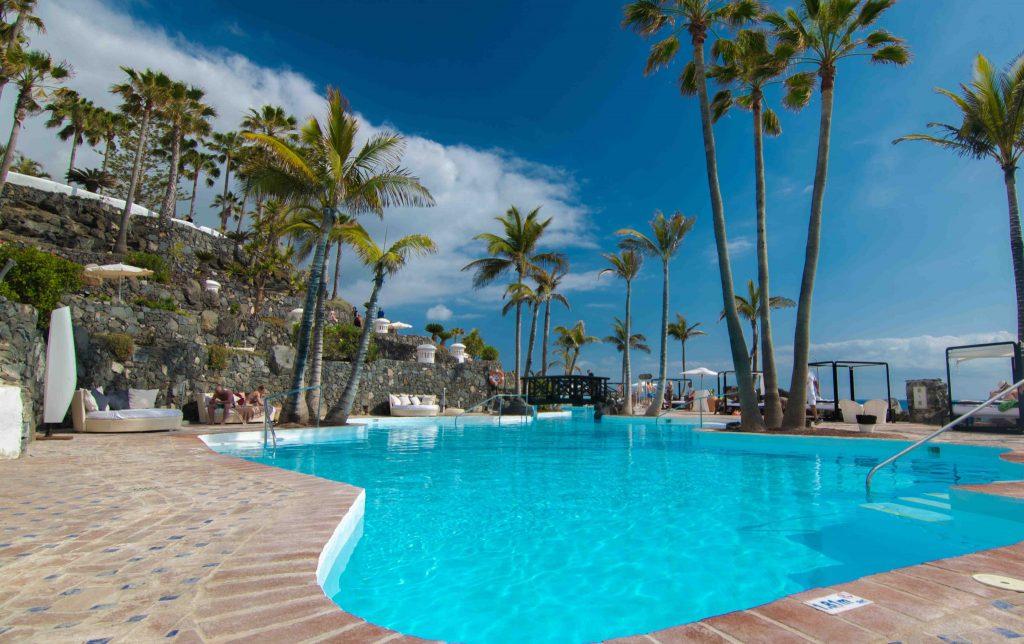 https://golftravelpeople.com/wp-content/uploads/2019/04/Hotel-Jardin-Tropical-Swimming-Pools-Gym-comp-6-1024x644.jpg