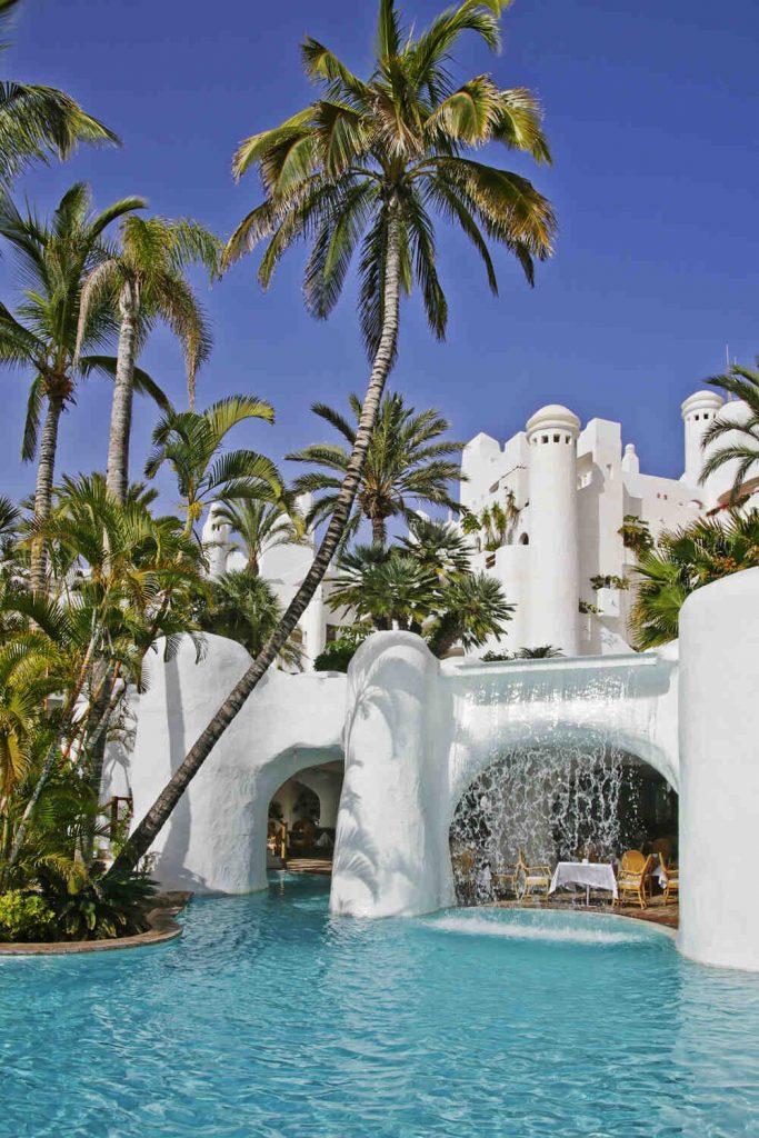 https://golftravelpeople.com/wp-content/uploads/2019/04/Hotel-Jardin-Tropical-Swimming-Pools-Gym-comp-7-683x1024.jpg