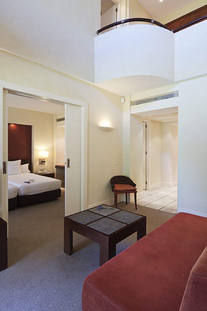 https://golftravelpeople.com/wp-content/uploads/2019/04/Islantilla-Golf-Resort-Hotel-Bedrooms-11-681x1024.jpg