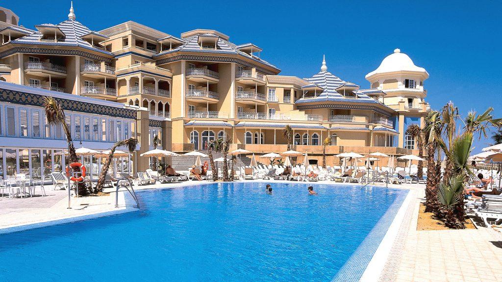https://golftravelpeople.com/wp-content/uploads/2019/04/Melia-Atlantico-Hotel-Isla-Canela-1024x576.jpg