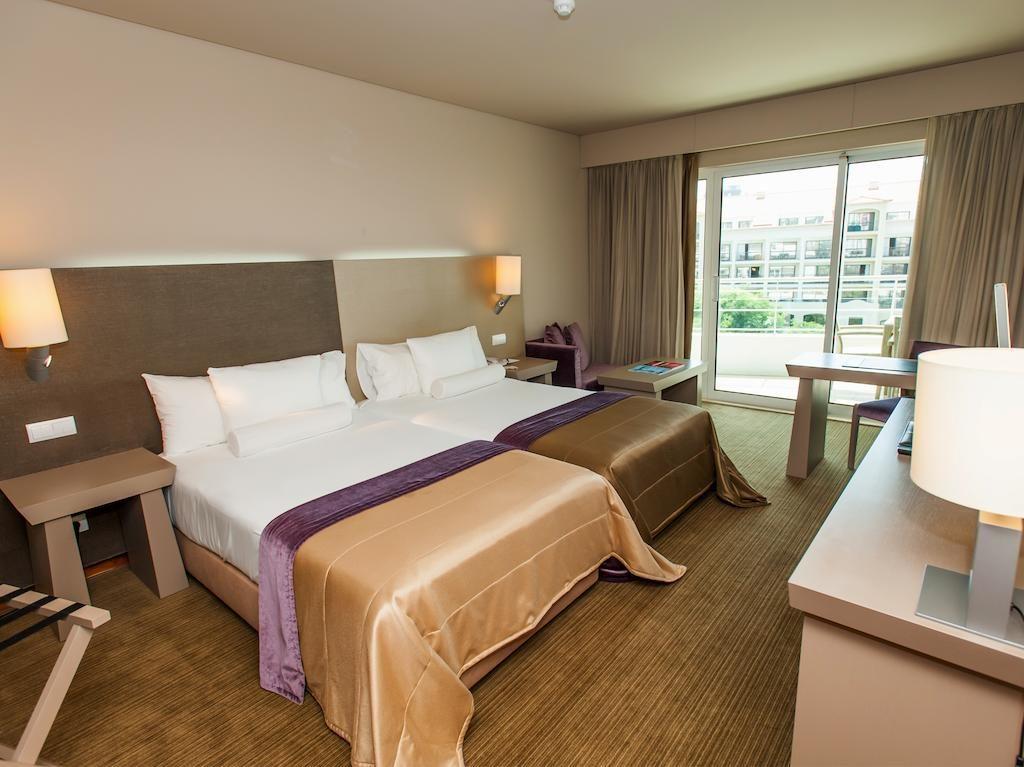 https://golftravelpeople.com/wp-content/uploads/2019/04/Melia-Madeira-Mare-Funchal-Bedrooms-10-1024x767.jpg