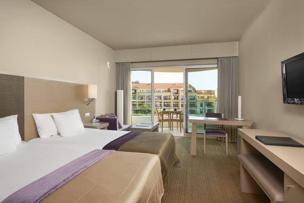 https://golftravelpeople.com/wp-content/uploads/2019/04/Melia-Madeira-Mare-Funchal-Bedrooms-13-1024x683.jpg