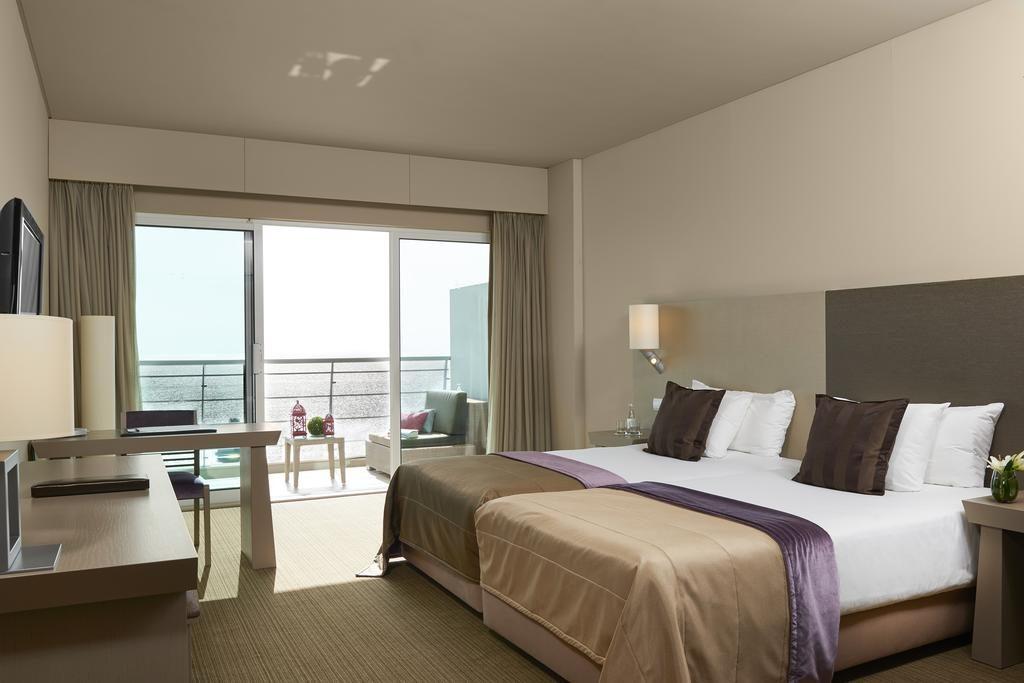 https://golftravelpeople.com/wp-content/uploads/2019/04/Melia-Madeira-Mare-Funchal-Bedrooms-17-1024x683.jpg