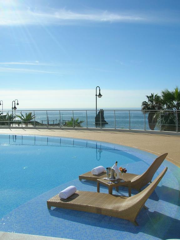 https://golftravelpeople.com/wp-content/uploads/2019/04/Melia-Madeira-Mare-Funchal-Swimming-Pools-3.jpg