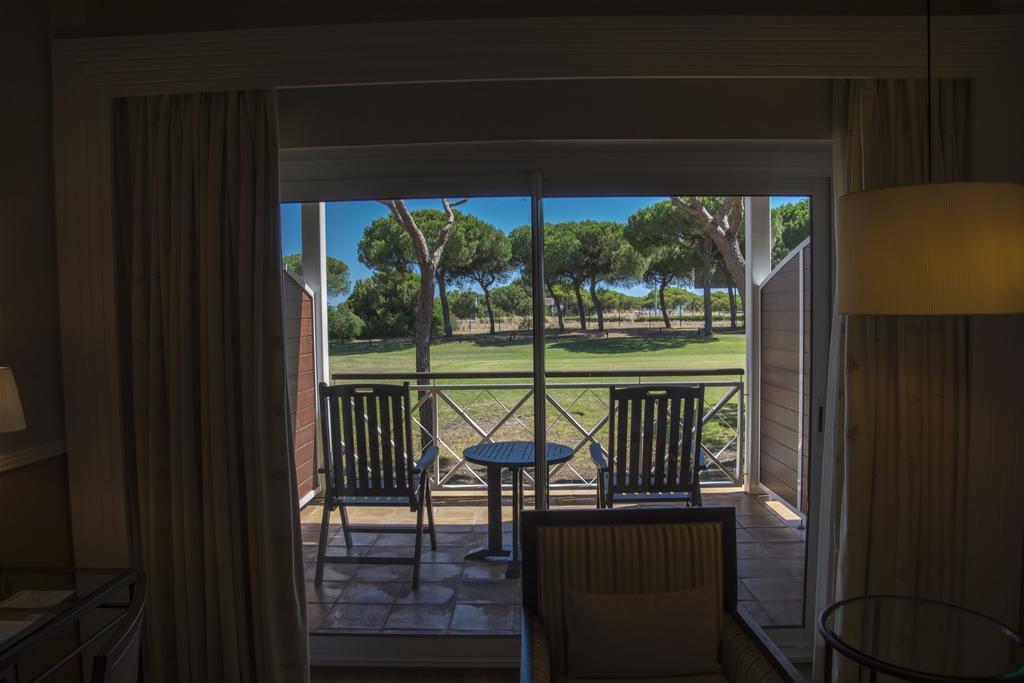 https://golftravelpeople.com/wp-content/uploads/2019/04/Nuevo-Portil-Golf-Hotel-Bedrooms-1.jpg