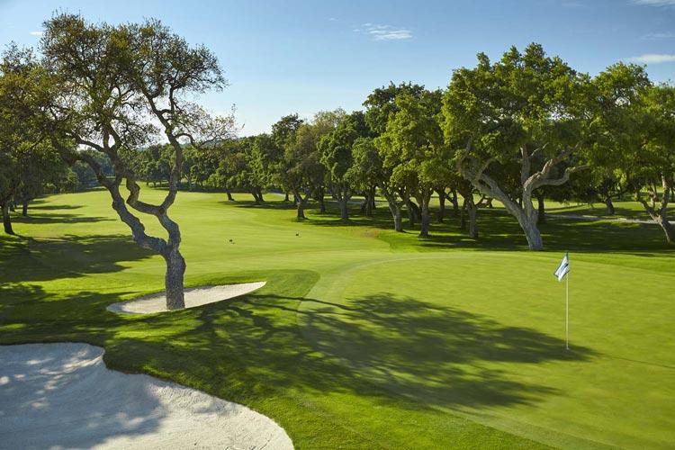 https://golftravelpeople.com/wp-content/uploads/2019/04/Real-Club-Valderrama-18.jpg