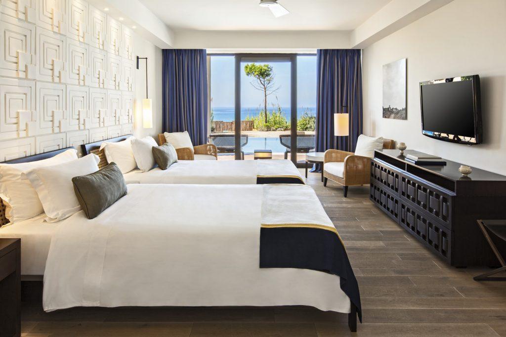 https://golftravelpeople.com/wp-content/uploads/2019/04/The-Romanos-Luxury-Collection-Resort-at-Costa-Navarino-Ambassador-Villas-Ithomi-Sapientza-Twin-Bedroom-1024x682.jpg