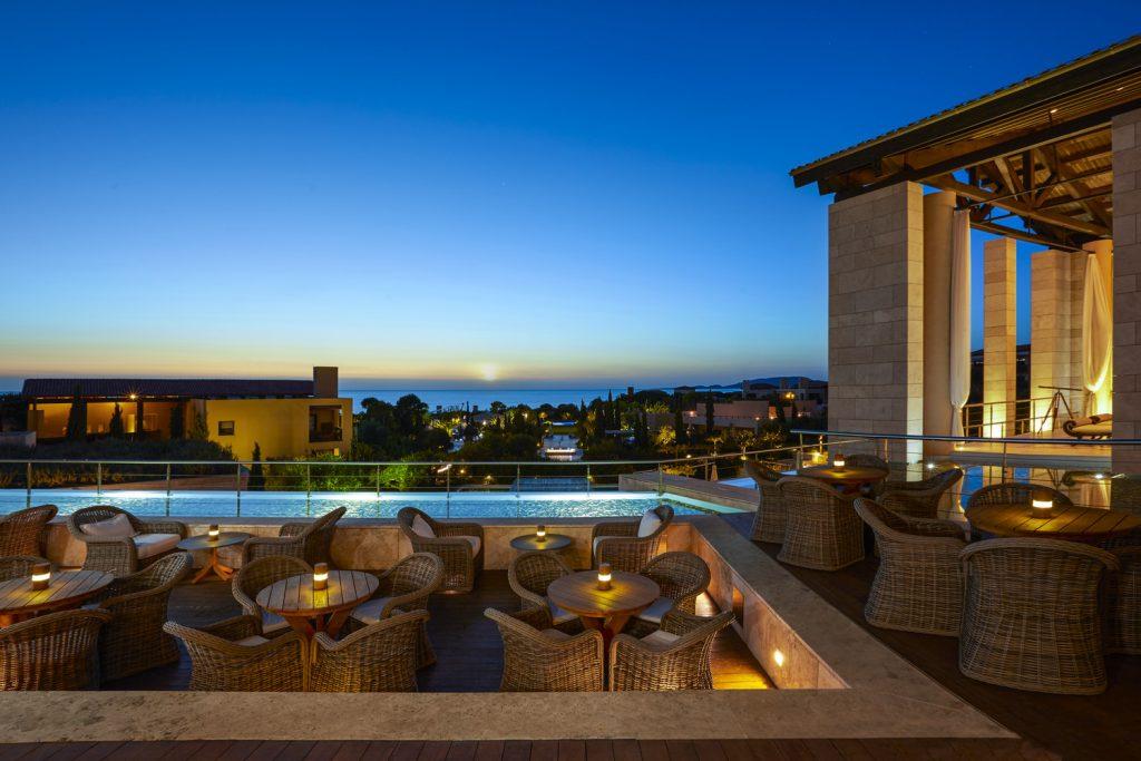 https://golftravelpeople.com/wp-content/uploads/2019/04/The-Romanos-Luxury-Collection-Resort-at-Costa-Navarino-Anax-Lounge-1024x683.jpg