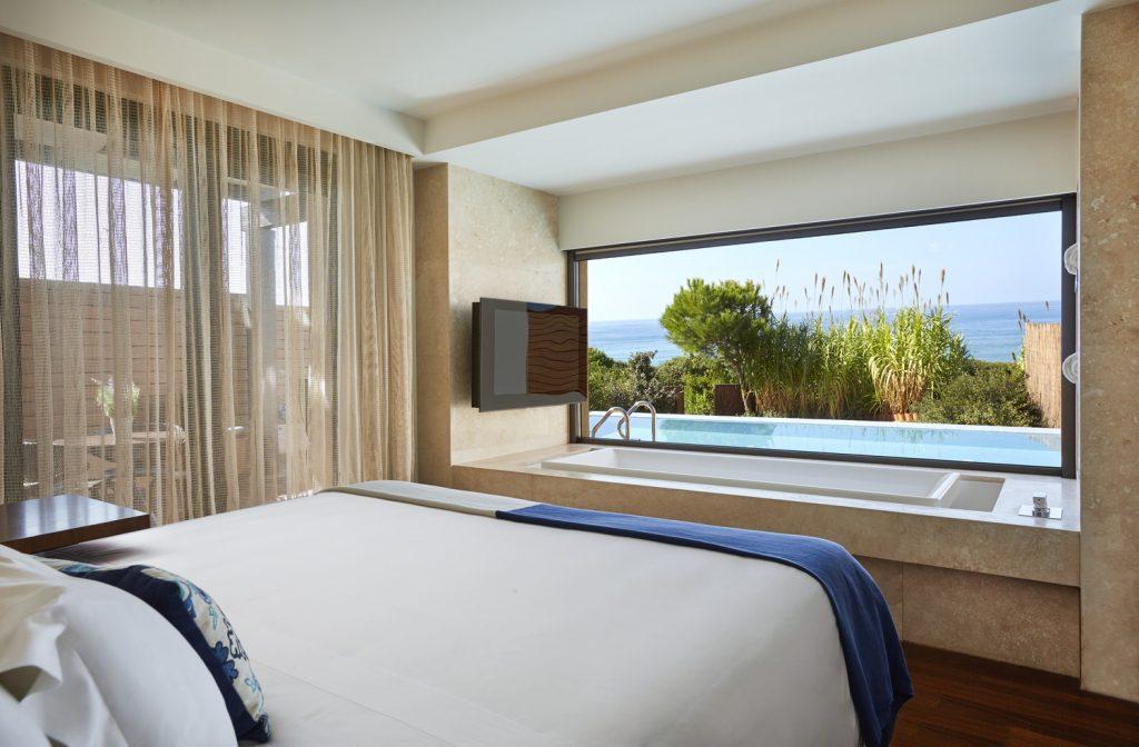 https://golftravelpeople.com/wp-content/uploads/2019/04/The-Romanos-Luxury-Collection-Resort-at-Costa-Navarino-Grand-Infinity-Suite-Sea-Bedroom-1024x672.jpg