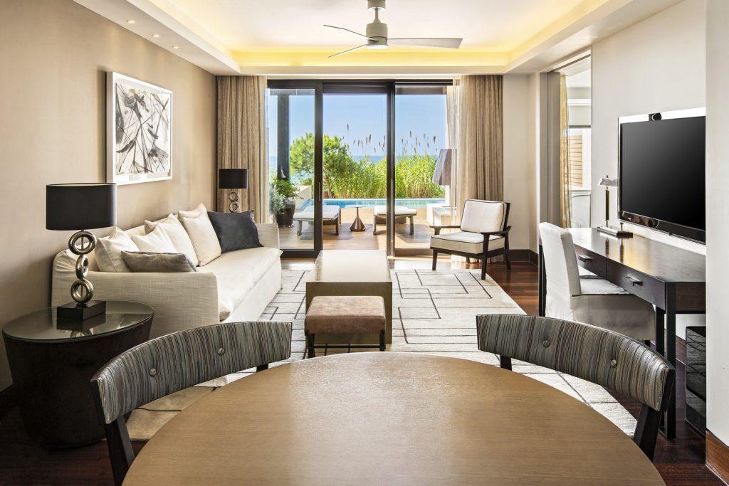 https://golftravelpeople.com/wp-content/uploads/2019/04/The-Romanos-Luxury-Collection-Resort-at-Costa-Navarino-Grand-Infinity-Suite-Sea-Living-Room-1024x683.jpg