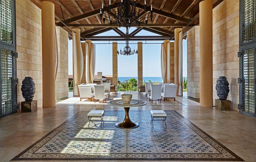 https://golftravelpeople.com/wp-content/uploads/2019/04/The-Romanos-Luxury-Collection-Resort-at-Costa-Navarino-Open-air-Lobby-1024x646.jpg