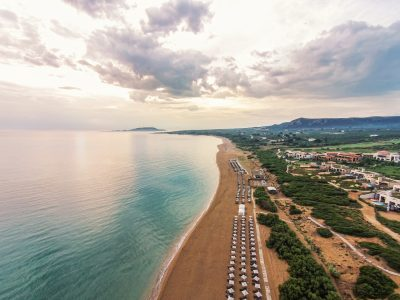https://golftravelpeople.com/wp-content/uploads/2019/04/The-Romanos-Luxury-Collection-Resort-at-Costa-Navarino-The-Dunes-Beach-400x300.jpg