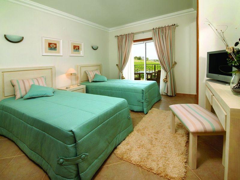 https://golftravelpeople.com/wp-content/uploads/2019/05/Boavista-Golf-Resort-3-bedroom-Villas-3.jpg