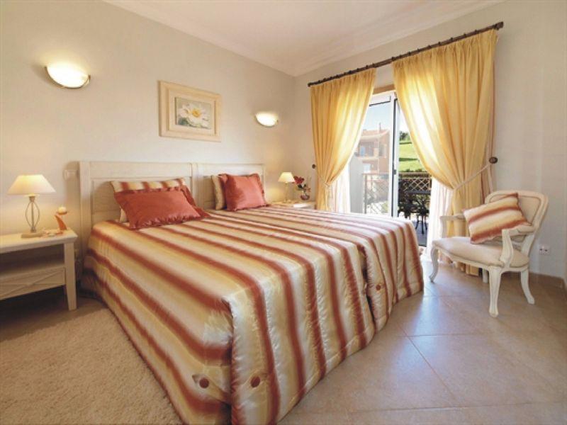 https://golftravelpeople.com/wp-content/uploads/2019/05/Boavista-Golf-Resort-4-bedroom-Villas-6.jpg