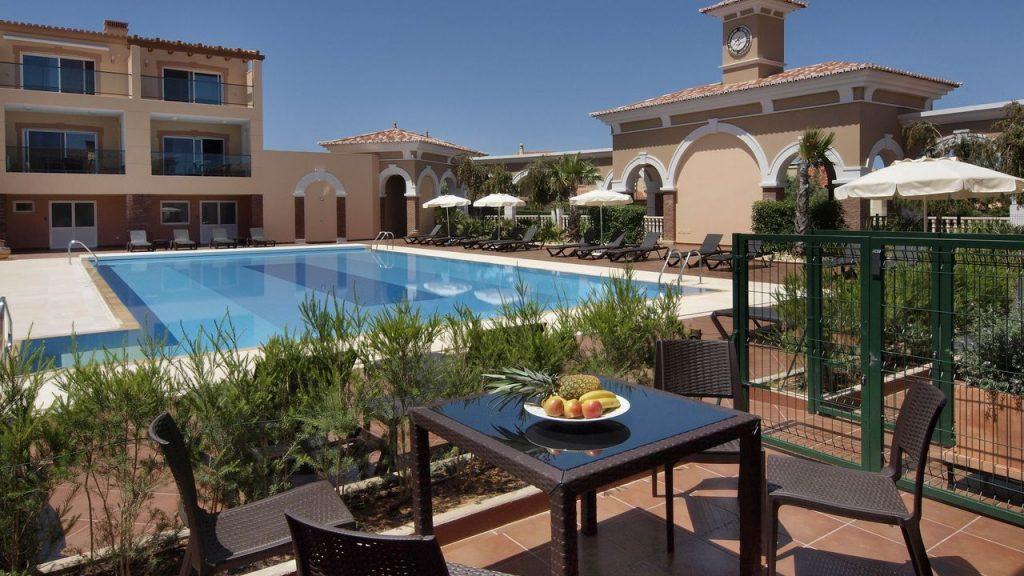 https://golftravelpeople.com/wp-content/uploads/2019/05/Boavista-Golf-Resort-Bela-Colina-Apartments-and-Townhouses-1-1024x576.jpg